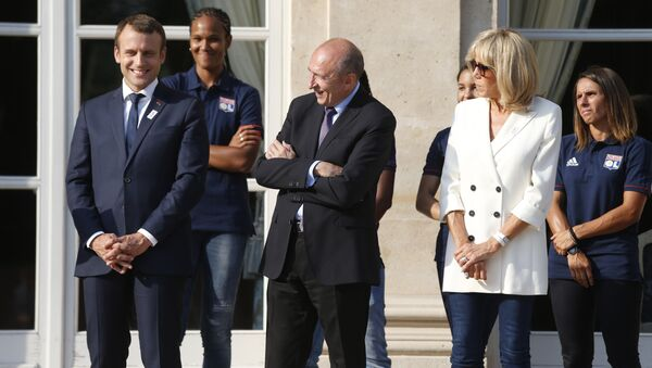 French President Emmanuel Macron (C), his wife Brigitte Macron (C) and French Interior Minister Gerard Collomb attend a ceremony to celebrate the victory of Lyon's football team during the UEFA Women's Champions League - Sputnik France