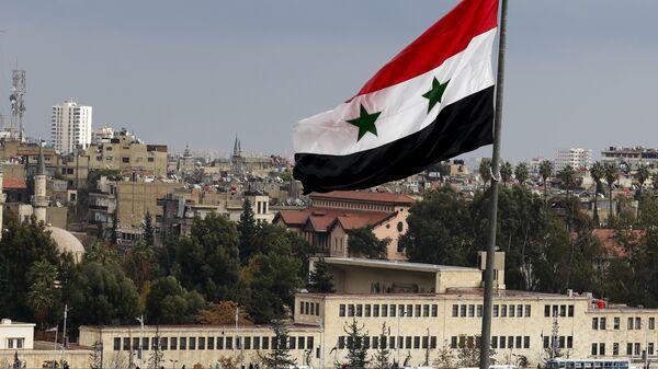 Le drapeau syrien à Damas, Syrie - Sputnik France