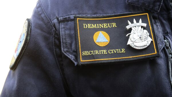 This photo taken on June 9, 2016 in Marly-le-Roi shows the patch of the member of the National Demining Unit of the Ministry of Interior. - Sputnik France