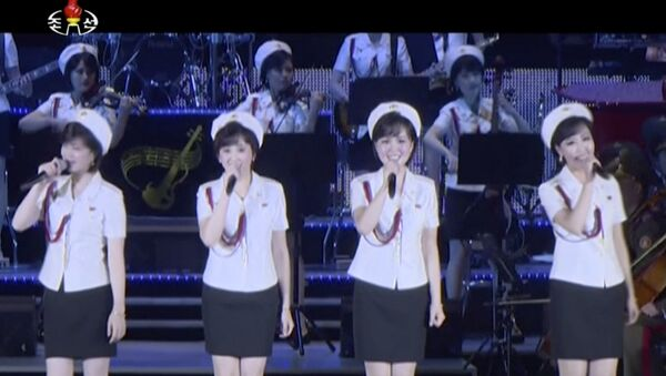 This image made from undated video of a news bulletin aired by North Korea's KRT on July 10, 2017, North Korea's Moranbong Band, an all-female ensemble that was hand-picked by leader Kim Jong Un, performs in Pyongyang. - Sputnik France
