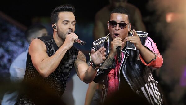FILE - In this April 27, 2017 file photo, singers Luis Fonsi, left and Daddy Yankee perform during the Latin Billboard Awards in Coral Gables, Fla. Malaysia has banned their hit song Despacito on state radio and television, though it might be hard to slow the song's record-breaking popularity. - Sputnik France