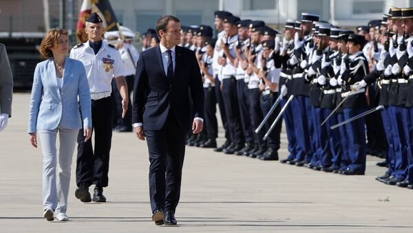 French President Emmanuel Macron (R), French Minister of the Armed Forces Florence Parly (C) and newly-named Chief of the Defence Staff French Army General Francois Lecointre (L) review troops as they arrive at the military base in Istres, southern France, July 20, 2017. - Sputnik France