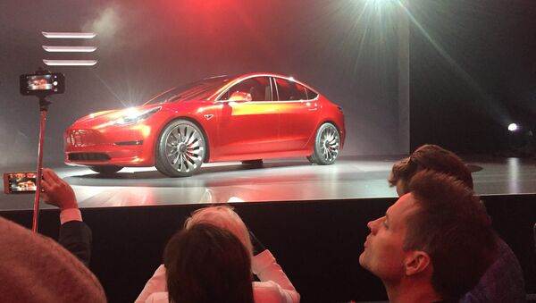A Tesla Model 3 sedan, its first car aimed at the mass market, is displayed during its launch in Hawthorne, California, March 31, 2016 - Sputnik France