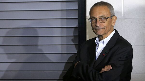 Campaign chairman John Podesta watches from the edge of the stage during a campaign rally with U.S. Democratic presidential nominee Hillary Clinton (not pictured) at Heinz Field in Pittsburgh, Pennsylvania, U.S. (File) - Sputnik France