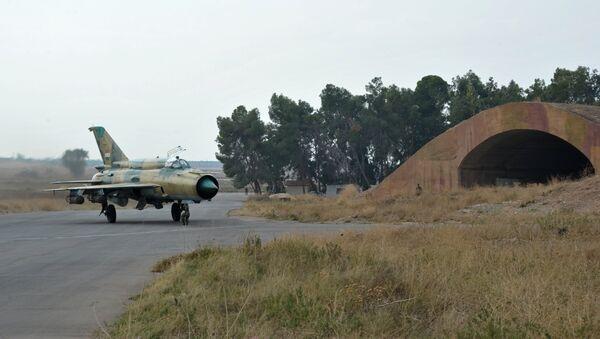Un MiG-21 de l'armée de l'air syrienne à la base aérienne de Hama - Sputnik France