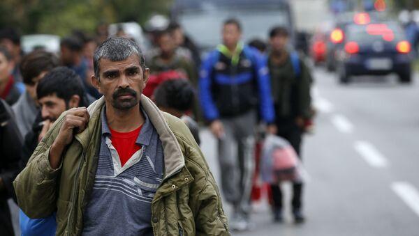 Les migrants - Sputnik France