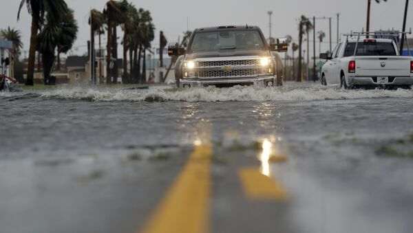 A truck drives moves through flood waters left behind by Hurricane Harvey, Saturday, Aug. 26, 2017, in Aransas Pass, Texas. - Sputnik France