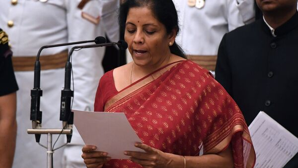India's ruling BJP politician and member of parliament Nirmala Sitharaman takes the oath during the swearing-in ceremony of new ministers at the Presidential Palace in New Delhi - Sputnik France