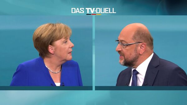 A screen that shows the TV debate between German Chancellor Angela Merkel of the Christian Democratic Union (CDU) and her challenger Germany's Social Democratic Party SPD candidate for chancellor Martin Schulz in Berlin, Germany, September 3, 2017. - Sputnik France