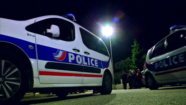 Police vehicles at the scene where a French police commander was stabbed to death in front of his home in the Paris suburb of Magnanville - Sputnik France