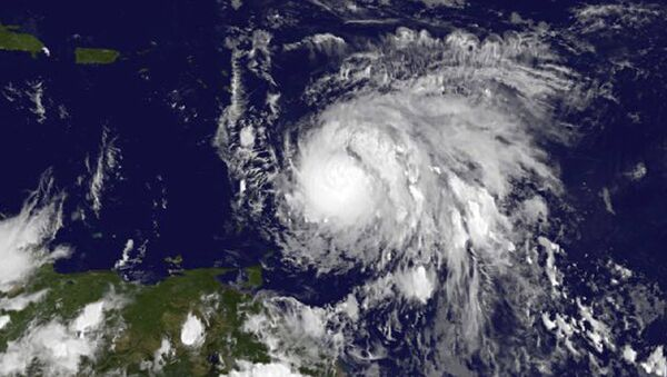 This Sunday, Sept. 17, 2017, GOES East satellite image provided by NASA taken at 7:45 p.m EDT, shows Hurricane Maria as it approaches the Lesser Antilles. - Sputnik France