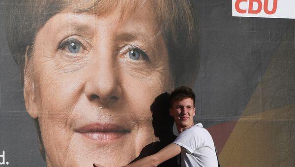 Merkel beim Urnengang in Berlin - Sputnik France