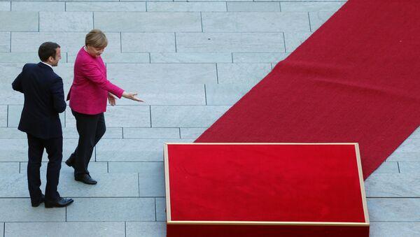 Das erste bilaterale Treffen von Emmanuel Macron und Angela Merkel in Berlin  - Sputnik France