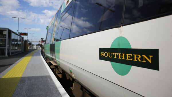 A Southern Rail logo is pictured on the side of a train carriage as t stands at a platform at East Croydon station, south of London - Sputnik France