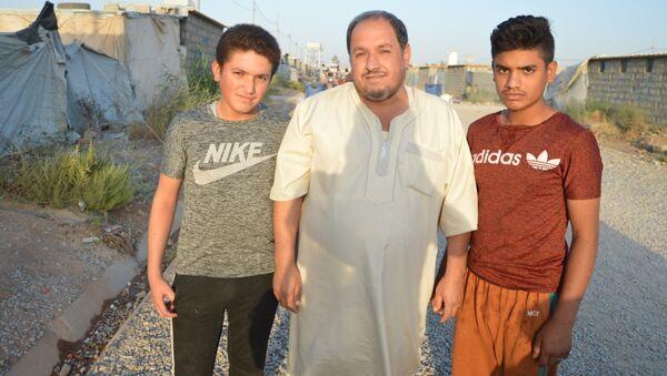 Une famille dans le camp de réfugiés à Erbil - Sputnik France