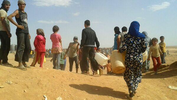 Les réfugiés syriens dans le camp d'Al-Rukban - Sputnik France