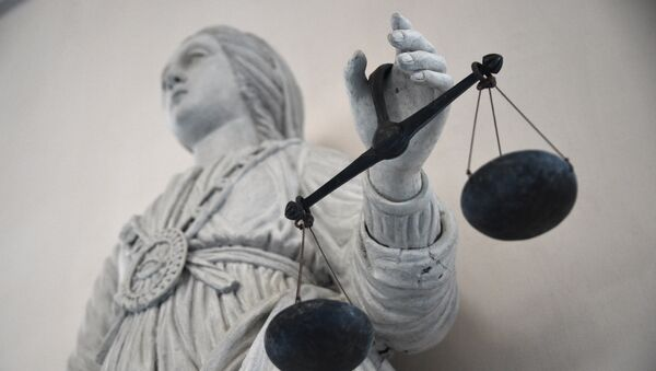 A picture taken on May 19, 2015 at Rennes' courthouse shows a statue of the goddess of Justice balancing the scales. - Sputnik France