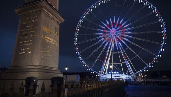 A picture taken on January 8, 2017 in Paris shows the Ferris wheel and the obelisk at the place de la Concorde. - Sputnik France