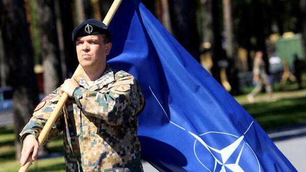 Un soldat letton lors de la cérémonie d'accueil des militaires canadiens de l'Otan à Adazi - Sputnik France