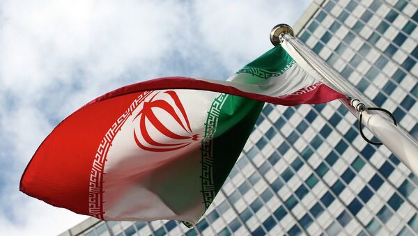 An Iranian flag flutters in front of the United Nations headquarters, during an International Atomic Energy Agency (IAEA) board of governors meeting, in Vienna, March 4, 2015. - Sputnik France