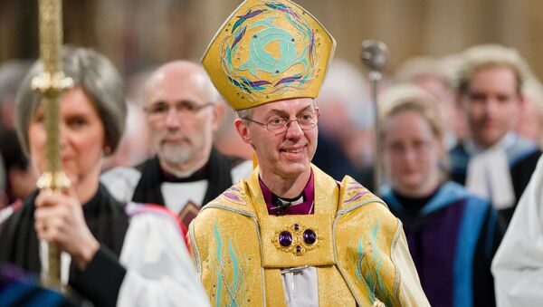 The Archbishop of Canterbury, Justin Welby (C) walks in procession after being Enthroned in Canterbury Cathedral in Canterbury on March 21, 2013. - Sputnik France