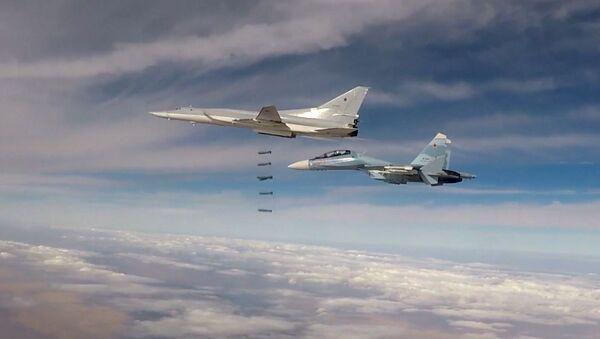 Des bombardiers lance-missiles Tu-22M3 lors d'un raid en Syrie - Sputnik France