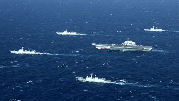 China's Liaoning aircraft carrier with accompanying fleet conducts a drill in an area of South China Sea in this undated photo taken December, 2016 - Sputnik France