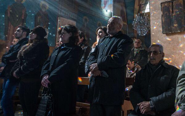 Lors d'un service dans une église à Homs - Sputnik France