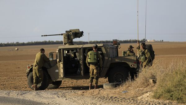 Israeli soldiers stand near the border with Gaza. (File) - Sputnik France