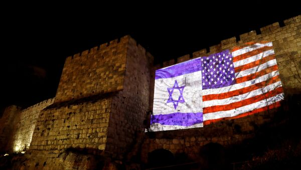 An Israeli national flag and an American one are projected on a part of the walls surrounding Jerusalem's Old City December 6, 2017. - Sputnik France