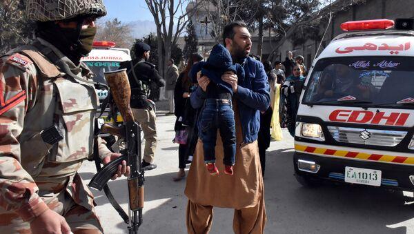 A man carries a boy as he shouts for an ambulance after gunmen attacked the Bethel Memorial Methodist Church in Quetta, Pakistan December 17, 2017 - Sputnik France