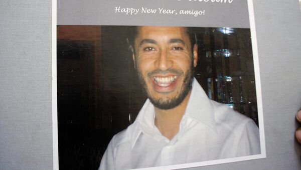 A reproduction of a photo of Moamer Kadhafi's son Saadi, from an album dated 2006 and sent to him as a new year's gift by a New York-based friend called Linda, is taken on August 29, 2011 after it was found at his abandoned rest house in Tripoli. - Sputnik France