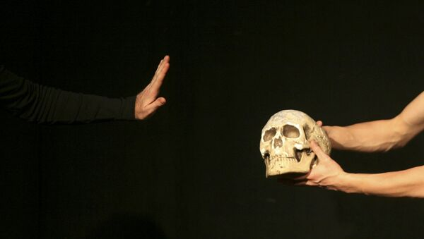 An actor performs during William Shakespeare's theatre play Hamlet at the Jerusalem Centre for the Performing Arts in this file photograph dated December 11, 2008. - Sputnik France