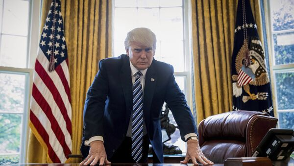 In this April 21, 2017, file photo, President Donald Trump poses for a portrait in the Oval Office in Washington after an interview with The Associated Press. - Sputnik France