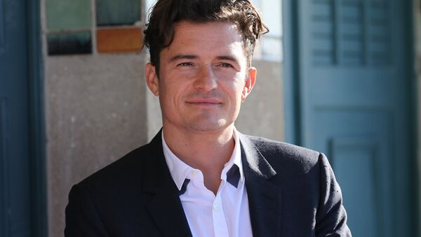 British actor Orlando Bloom poses during the unveiling of his dedicated beach locker room on the Promenade des Planches on September 6, 2015 - Sputnik France