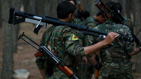 Des membres des Unités kurdes de protection du peuple  - Sputnik France