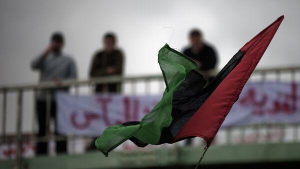 Bandera de Libia en la ciudad de Derna (archivo) - Sputnik France