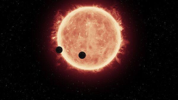 Vue d'artiste des planètes TRAPPIST-1b et TRAPPIST-1c sur fond d'une naine rouge - Sputnik France