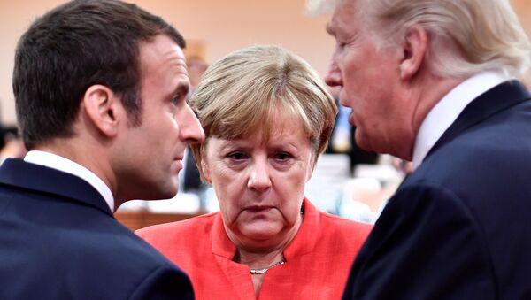 Emmanuel Macron, Angela Merkel et Donald Trump à Hambourg le 7 juillet 2017. - Sputnik France