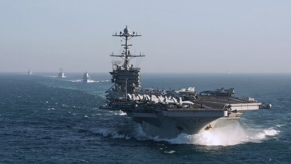 The aircraft carrier group of the United States Navy led by USS Harry S. Truman, front, and a ship escort are seen leaving the port of Norfolk heading for the Middle East - Sputnik France
