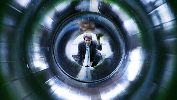 A man looks into a tube representing a natural gas pipeline at the booth of Nord Stream at the Hanover industrial fair in Hanover, Germany (File) - Sputnik France