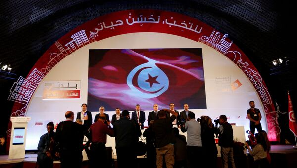 Mohamed Tlili Mansri (C), president of the Independent High Authority for Elections (ISIE), attends a news conference to announce the results of the municipal election in Tunis, Tunisia, May 9, 2018. - Sputnik France