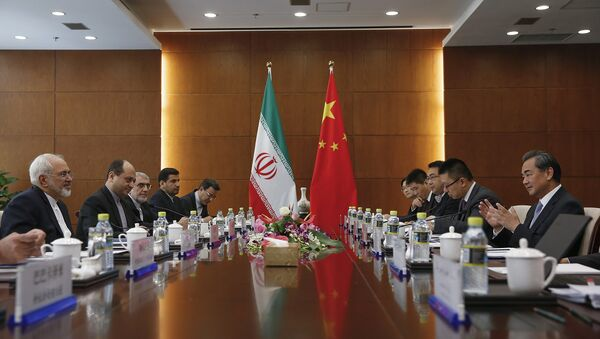 Chinese Foreign Minister Wang Yi, right, and Iranian Foreign Minister Mohammad Javad Zarif, left, attend a bilateral meeting Tuesday, Sept. 15, 2015 in Beijing, China - Sputnik France