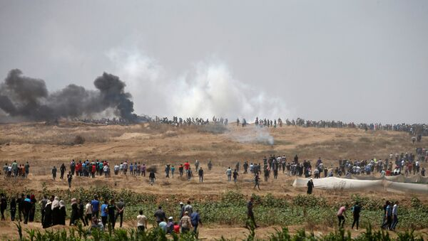 Palestinian demonstrators gather during a protest against U.S. embassy move to Jerusalem and ahead of the 70th anniversary of Nakba, at the Israel-Gaza border, east of Gaza City May 14, 2018. - Sputnik France