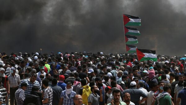 Palestinian demonstrators gather during a protest against U.S. embassy move to Jerusalem and ahead of the 70th anniversary of Nakba, at the Israel-Gaza border in the southern Gaza Strip May 14, 2018. - Sputnik France
