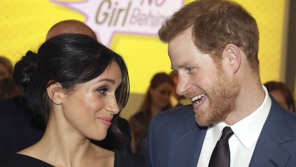 Britain's Prince Harry, left and Meghan Markle attend a women's empowerment reception at the Royal Aeronautical Society, during the Commonwealth Heads of Government Meeting, in London, Thursday April 19, 2018. - Sputnik France