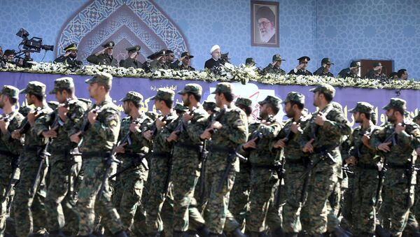 Iran's President Hassan Rouhani, top center, reviews army troops marching during the 37th anniversary of Iraq's 1980 invasion of Iran, in front of the shrine of the late revolutionary founder, Ayatollah Khomeini, just outside Tehran, Iran, Friday, Sept. 22, 2017 - Sputnik France
