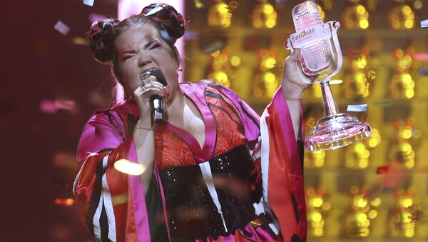 Netta from Israel celebrates after winning the Eurovision song contest in Lisbon, Portugal, Saturday, May 12, 2018 during the Eurovision Song Contest grand final. - Sputnik France