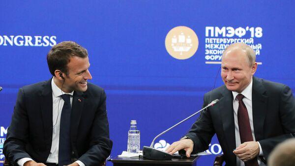 Poutine et Macron au Forum économique international de Saint-Pétersbourg 2018 - Sputnik France