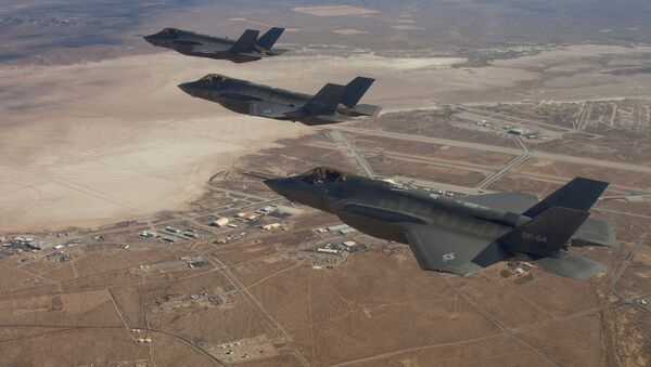 Three F-35 Joint Strike Fighters, (rear to front) AF-2, AF-3 and AF-4, flies over Edwards Air Force Base in this December 10, 2011 handout photo provided by Lockheed Martin - Sputnik France